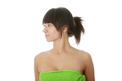 Attractive young nude woman in green towel Stock Photography
