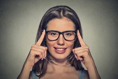 Attractive young optician woman with brown eyes in glasses Royalty Free Stock Images