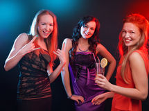 Attractive young people dancing at disco and having fun Royalty Free Stock Photo