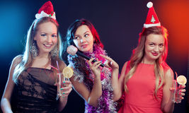 Attractive young people dancing at disco and having fun Royalty Free Stock Image