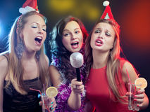Attractive young people dancing at disco and having fun Stock Photos