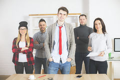 Attractive young people in office Stock Photo