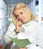 Attractive young pharmacist Royalty Free Stock Photos