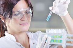 Attractive young PhD student scientist in laboratory Royalty Free Stock Image