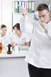 Attractive young PhD students scientists in the laboratory Stock Images