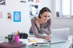 Attractive young photo artist is using a laptop Stock Image