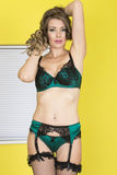 Attractive Young Pin Up Woman in Emerald Green and Black Lingerie Royalty Free Stock Photo