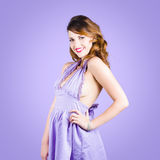 Attractive young pinup girl in retro purple dress Royalty Free Stock Image