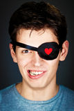 Attractive young pirate. Attractive young amorous pirate in the eye-band Stock Photos
