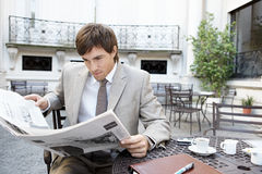 Business man reading paper. Royalty Free Stock Photos