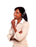 Attractive young receptionist wearing headset Stock Photo