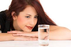 Attractive young red haired girl with a glass of Royalty Free Stock Image