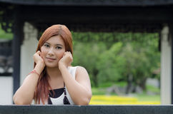 Attractive young redhead Asian woman Stock Photo