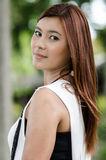 Attractive young redhead Asian woman Royalty Free Stock Photos