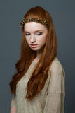 Attractive young redhead woman with hoop on her head Stock Images