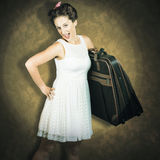 Attractive young 1950s woman ready for travel tour Stock Photography