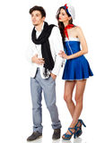 Attractive young sailor woman seducing elegant man. Beautiful young couple. Sexy women in sailor uniform seducing elegant man. Isolated on white background. High Stock Photos