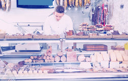 Attractive young seller at butcher market Royalty Free Stock Photo
