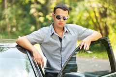 Attractive young serious man car Royalty Free Stock Image