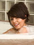 Attractive young sexy female taking bath. Sensual sexy woman relaxing in bath foam Stock Image