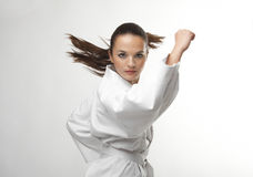 Attractive young sexy women in a karate pose. Attractive young sexy woman in a karate pose isolated on white Stock Photo