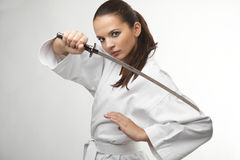 Attractive young sexy women with samurai sword Stock Photography