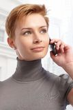 Young woman on the phone. Attractive young short haired woman using cellphone Royalty Free Stock Photo