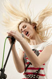 Attractive young singer performs with passion Stock Photos