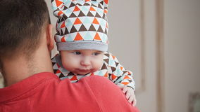 Attractive young single dad spending some time with his baby at home stock video footage