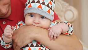 Attractive young single dad spending some time with his baby at home stock footage