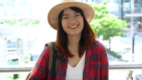 Attractive young smiling Asian woman outdoors portrait in the city real people series. stock video