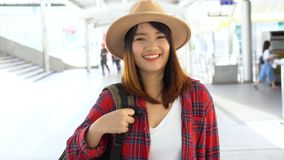 Attractive young smiling Asian woman outdoors portrait in the city real people series. stock footage