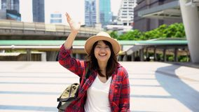 Attractive young smiling Asian woman outdoors portrait in the city real people series. Outdoors lifestyle fashion portrait. stock video