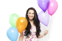 Attractive Young Smiling Brunette holding Colorful Balloons Stock Photos