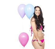Attractive Young Smiling Brunette holding Colorful Balloons Stock Photography