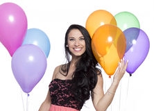 Attractive Young Smiling Brunette holding Colorful Balloons Royalty Free Stock Photography