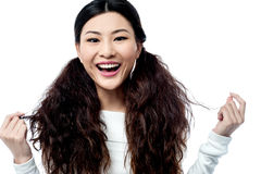 Attractive young smiling chinese girl Stock Photography
