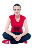 Attractive young smiling girl looking at you Stock Photography
