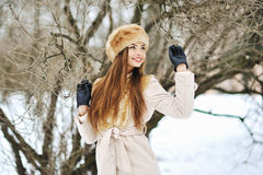 Attractive young smiling girl in winter Stock Photo