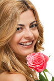 Attractive young smiling woman with flowers roses isolated Royalty Free Stock Image