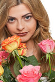 Attractive young smiling woman with flowers roses isolated Royalty Free Stock Photos