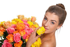 Attractive young smiling woman with flowers roses isolated Stock Images