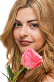 Attractive young smiling woman with flowers roses isolated Stock Image