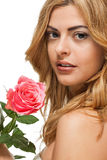 Attractive young smiling woman with flowers roses isolated Royalty Free Stock Images