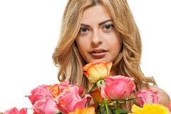 Attractive young smiling woman with flowers roses isolated Stock Photo