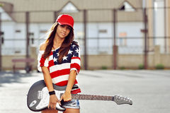 Attractive young smiling woman with guitar Stock Image