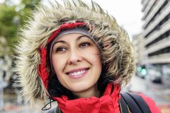 Attractive smiling woman in jacket with fur hood. Royalty Free Stock Image