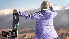 Attractive young snowboard girl smiling in camera with OK Gesture stock video footage