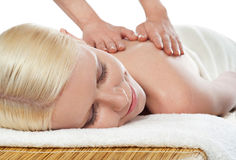 Attractive young spa lady getting a massage Royalty Free Stock Photos