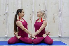 Attractive young sport girls are doing yoga together. Group training. Healthy lifestyle concept stock image